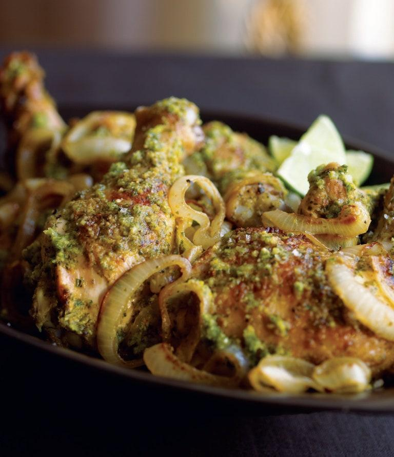 """This is like pouring a cooked mojito over stewed chicken, with the rum, lime, and herbs mingling beautifully with the chicken juices. It's a very good combination. <a href=""""https://www.epicurious.com/recipes/food/views/minty-boozy-chicken?mbid=synd_yahoo_rss"""" rel=""""nofollow noopener"""" target=""""_blank"""" data-ylk=""""slk:See recipe."""" class=""""link rapid-noclick-resp"""">See recipe.</a>"""