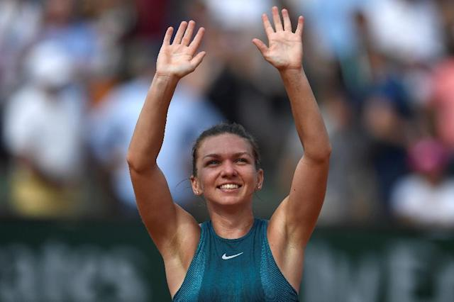 Champion: Simona Halep celebrates victory over Sloane Stephens in the final (AFP Photo/CHRISTOPHE SIMON)