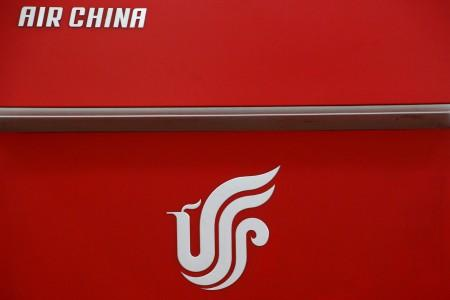 FILE PHOTO: Air China's logo is seen on a counter of Air China at a terminal of Beijing Capital International Airport in Beijing