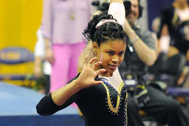 In this March 8, 2013, photo provided by LSU Student Media, LSU senior Britney Taylor finishes her floor routine at a gymnastics event in Baton Rouge, La. New England Patriots wide receiver Antonio Brown has been accused of rape by a former trainer. Britney Taylor says Brown sexually assaulted her on three occasions, according to a lawsuit filed Tuesday, Sept. 10, 2019, in the Southern District of Florida. (Lauren Duhon/LSU Student Media via AP)