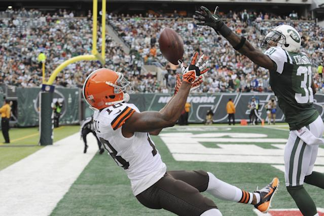 New York Jets cornerback Antonio Cromartie (31) breaks up a pass to Cleveland Browns' Greg Little (18) during the first half of an NFL football game on Sunday, Dec. 22, 2013, in East Rutherford, N.J. (AP Photo/Bill Kostroun)