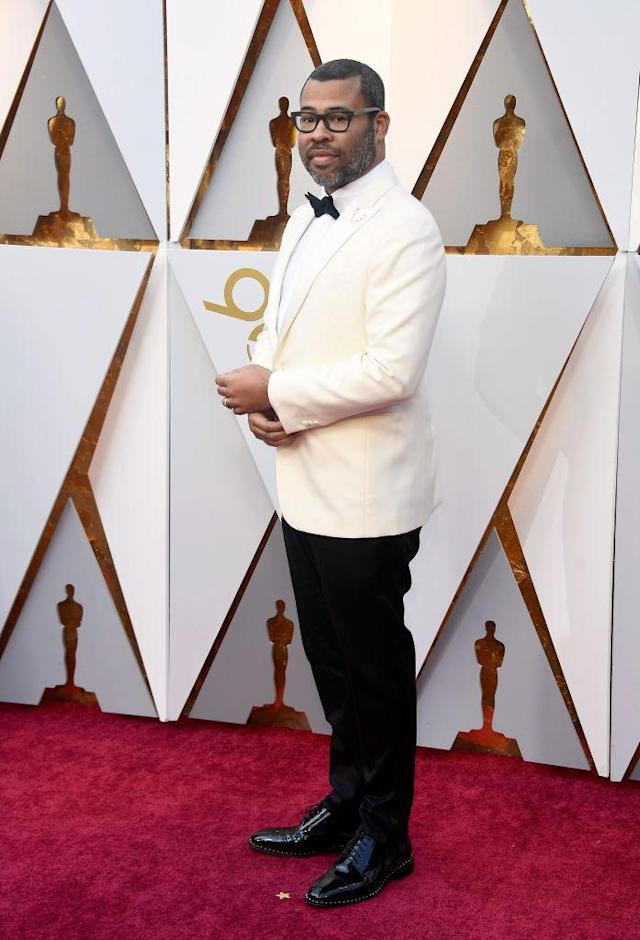 <p>Peele also went with white, wearing a light suit jacket with a deer antler pin as an ode to his film <em>Get Out</em>. (Photo: Getty Images) </p>
