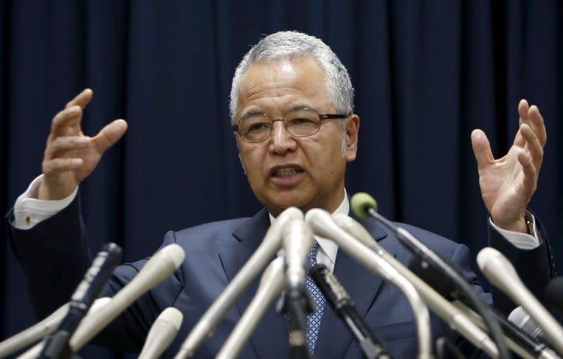 FILE PHOTO: Japan's Economics Minister Amari speaks during a news conference in Tokyo