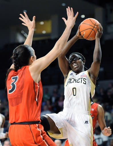 Georgia Tech guard Brittany Jackson (0) shoots as Georgia guard Anne Marie Armstrong (3) defends during the first half of an NCAA women's college basketball game in Atlanta, Sunday, Dec. 2, 2012. (AP Photo/John Amis)