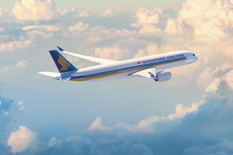 A Singapore Airlines plane in the clouds