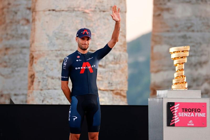 Team Ineos rider Italys Filippo Ganna waves on stage at the Doric Temple of Segesta near Palermo Sicily on October 1 2020 during an opening ceremony of presentation of participating teams and riders two days ahead of the departure of the Giro dItalia 2020 cycling race Photo by Luca Bettini AFP Photo by LUCA BETTINIAFP via Getty Images