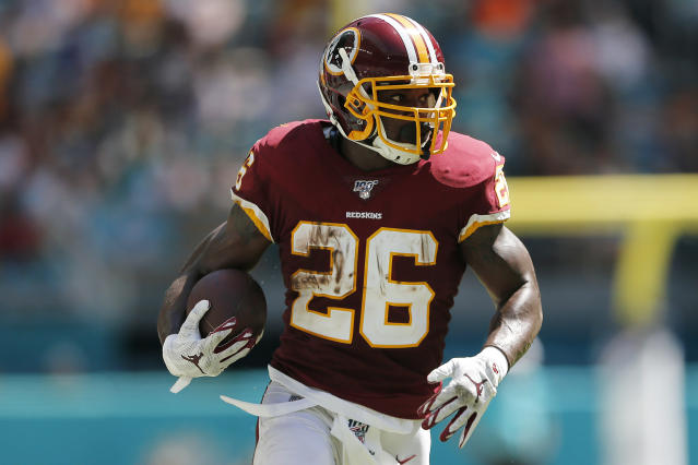 Big day: 34-year-old Adrian Peterson rushed for 118 yards on Sunday against Miami. (Getty Images)