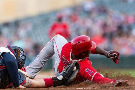 Jun 9, 2018; Minneapolis, MN, USA; Los Angeles Angels left fielder Justin Upton (8) is tagged out at home plate by Minnesota Twins catcher Bobby Wilson (46) during the eighth inning at Target Field. Mandatory Credit: Harrison Barden-USA TODAY Sports