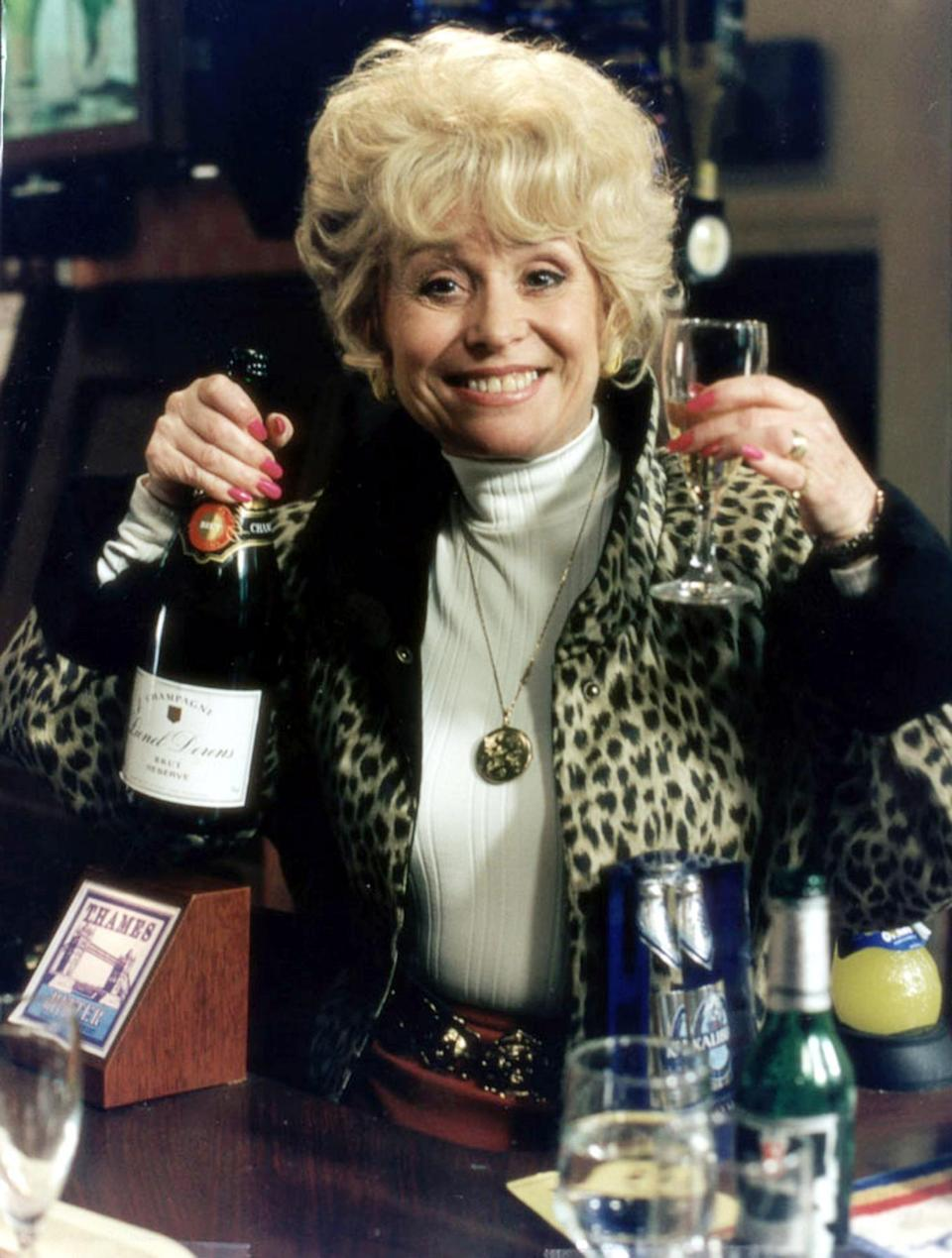 Dame Barbara Windsor as Queen Vic landlady Peggy Mitchell in EastEnders (Credit: BBC/PA)