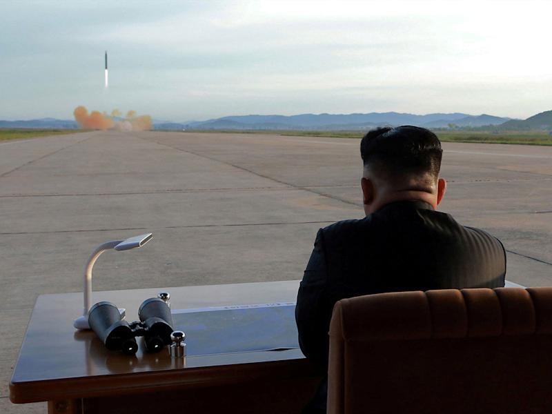 North Korean leader Kim Jong-un watches the launch of a Hwasong-12 missile: Reuters