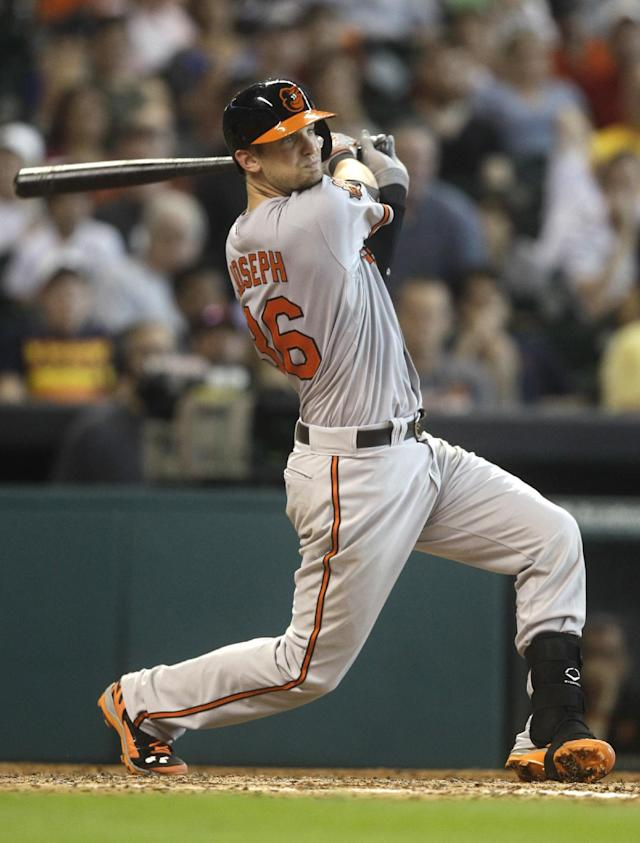 Baltimore Orioles' Caleb Joseph watches his single to right field during the fifth inning of a baseball game against the Houston Astros, Saturday, May 31, 2014, in Houston. (AP Photo/Patric Schneider)