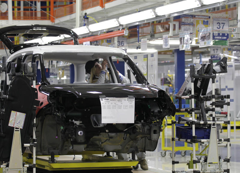 An employee works on a Fiat 500 L car in the assembly hall in the new Fiat factory, in Kragujevac, some 100 kilometers (70 miles) south of Belgrade, Serbia, Monday, April 16, 2012. Italian carmaker Fiat has opened a production line in Serbia for its new 500L family model, to expand on the popularity of its two-door 500 city car. Fiat hopes to sell about 160,000 hatchbacks a year produced in this central Serbian town, to take advantage of low wages, tax breaks and government subsidies. (AP Photo/Darko Vojinovic)