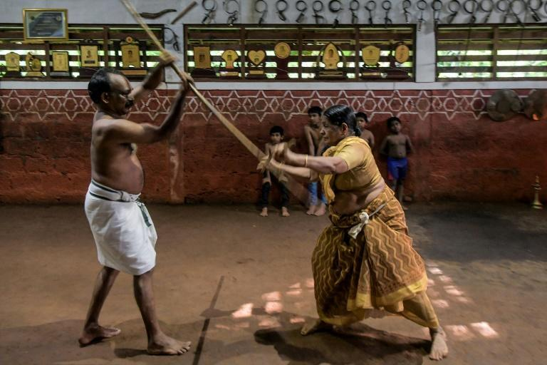 Kalari, which contains elements of dance and yoga, can involve weapons such as swords, shields and staffs (AFP/Manjunath Kiran)