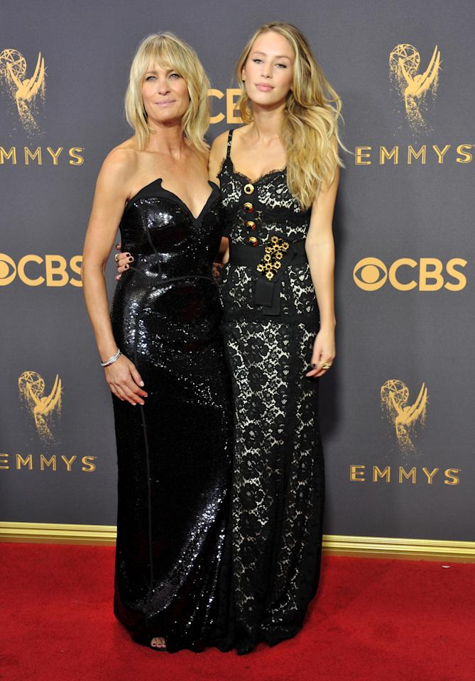 """<p>""""House of Cards"""" star Robin Wright brought her 26-year-old daughter Dylan Penn to the Emmys red carpet — the duo stunned in glittering black dresses. </p>"""