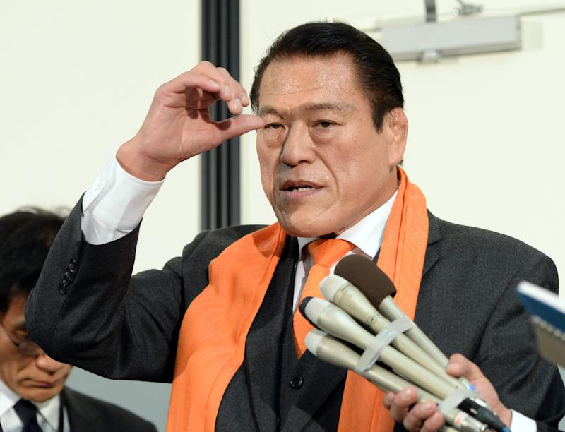 Former Japanese professional wrestler and a Japanese parliament member Antonio Inoki -- real name Kanji Inoki -- speaks to reporters as he returns from North Korea at the Tokyo international airport on January 16, 2014