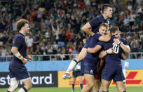 Scotland players celebrate during the Rugby World Cup Pool A game at Shizuoka Stadium Ecopa between Scotland and Russia in Shizuoka, Japan, Wednesday, Oct. 9, 2019. (AP Photo/Christophe Ena)