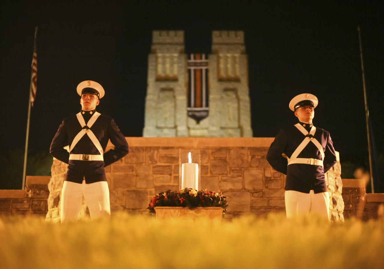 Members of the Virginia Tech Corps of Cadets stand guard for 32 minutes following the lighting of a ceremonial candle at midnight on the Virginia Tech campus, Monday, April 16 2012, in Blacksburg, Va. The candle will remain lit for the duration of the day and will be guarded again by cadets for 32 minutes prior to removal at midnight. Each anniversary since the April 2007, massacre on the Virginia Tech campus, classes have been suspended for the day in memory of the 32 students and faculty killed in the rampage by a lone gunman who then killed himself. On Monday, the fifth anniversary of the deadliest mass shooting in modern U.S. history, the 28,000 students on campus will head to class to honor the 32.  (AP Photo/The Roanoke Times, Daniel Lin)