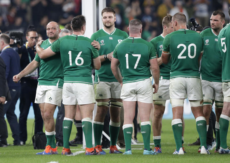 Ireland's Rory Best, left, is embraced by teammate Ireland's Peter O'Mahony as they leave the field following the Rugby World Cup quarterfinal match at Tokyo Stadium between New Zealand and Ireland in Tokyo, Japan, Saturday, Oct. 19, 2019. (AP Photo/Mark Baker)