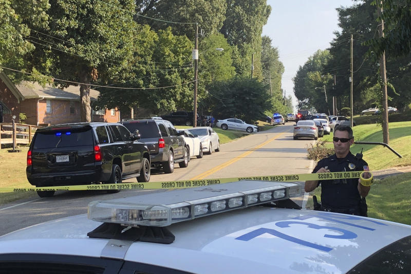 Police cordon off the scene of a shooting in Memphis, Tenn., on Wednesday, Sept. 18, 2019. Officials say two deputies have been injured and a suspect has died in the shooting. (AP Photo/Adrian Sainz)