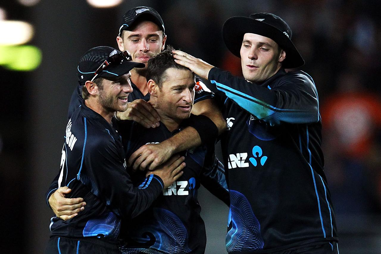 AUCKLAND, NEW ZEALAND - JANUARY 25:  Nathan McCullum of New Zealand is congratulated by teammates Tim Southee, Kane Williamson and Mitchell McClenaghan after taking the wicket of Ravichandran Ashwin of India during the One Day International match between New Zealand and India at Eden Park on January 25, 2014 in Auckland, New Zealand.  (Photo by Anthony Au-Yeung/Getty Images)