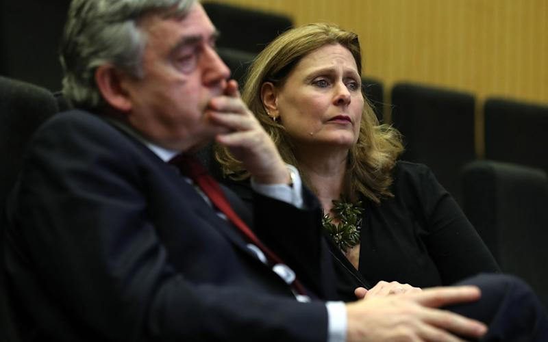 Former prime minister Gordon Brown and his wife Sarah as they listen to speeches at the Jennifer Brown Research Laboratory - Credit: PA/Andrew Milligan