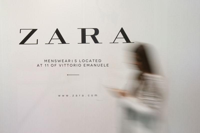 6eefb184 A woman walks in front of an advertisement for an Inditex owned Zara store  in Milan