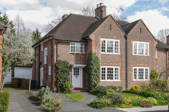 Buyers have been moving away from smaller properties, such as flats, to more spacious homes, according to a study. Above, a semi-detached house with garden in Pinner, London. Photo: Getty