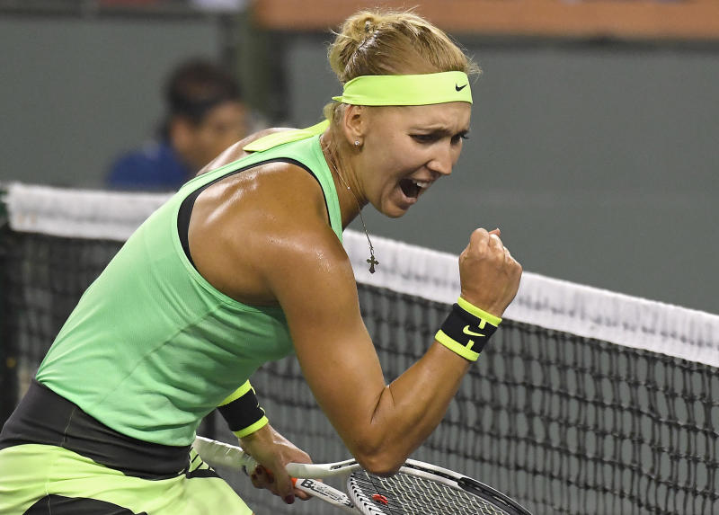 Elena Vesnina, of Russia, celebrates after winning a point during her match against Venus Williams at the BNP Paribas Open tennis tournament, Thursday, March 16, 2017, in Indian Wells, Calif. Vesnina won 6-2, 4-6, 6-3. (AP Photo/Mark J. Terrill)
