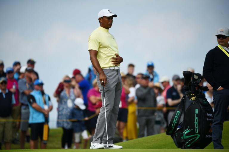 Send in the crowds: Tiger Woods drew a big following for his practice round at Royal Portrush on Monday