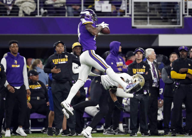 Vikings wide receiver Stefon Diggs (14) makes a catch over Saints free safety Marcus Williams (43) on his way to the game-winning touchdown Sunday in Minneapolis. The Vikings defeated the Saints 29-24. (AP)