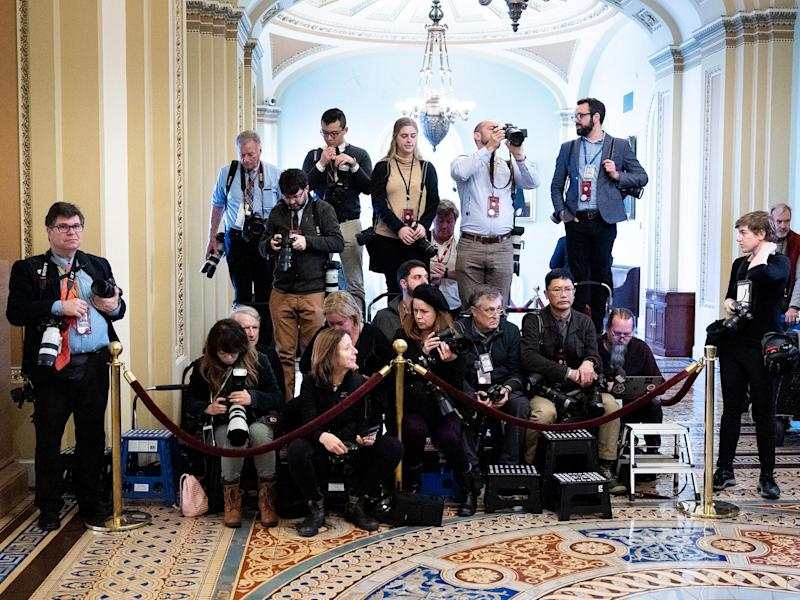Press photographers covering the trial are confined to a small enclosure: Barcroft Media/Getty