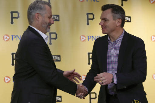Derek Shelton, left, shakes hands with general manager Ben Cherington as he is introduced as the new manager of the Pittsburgh Pirates baseball team at a news conference, Wednesday, Dec. 4, 2019, in Pittsburgh. (AP Photo/Keith Srakocic)