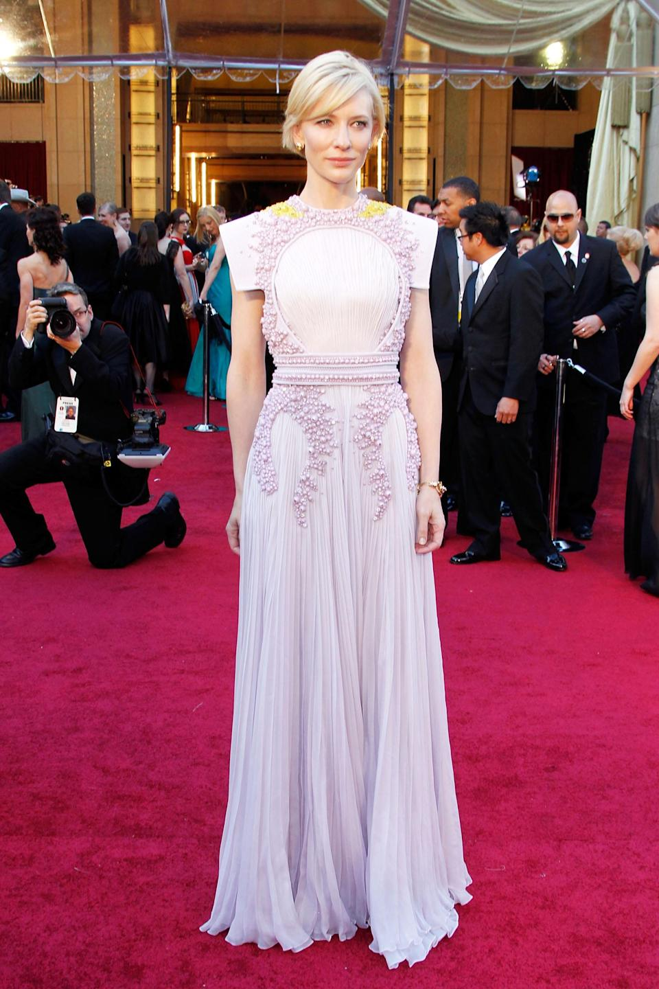 <h2>Cate Blanchett, 2011<br></h2><br>In this lavender Haute Couture gown by Givenchy, Cate Blanchett wasn't just an award-winning actress — she's a damn fashion <em>icon.</em><br><br><em>Cate Blanchett in Givenchy Haute Couture.</em>