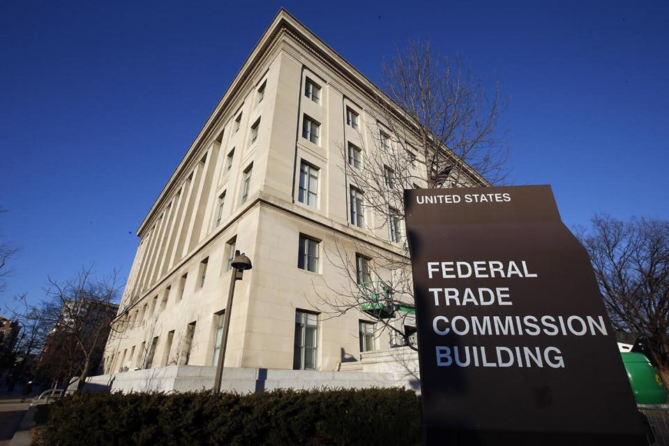 FILE - This Jan. 28, 2015, file photo, shows the Federal Trade Commission building in Washington. Federal regulators are amping up their investigation of the market dominance of five giant tech companies, demanding detailed information on their acquisitions back to 2010.  The Federal Trade Commission announced the move Tuesday, issuing orders to Facebook, Amazon, Apple, Microsoft and Google's parent Alphabet Inc. (AP Photo/Alex Brandon, File)