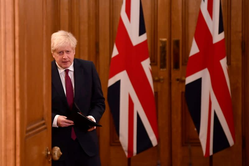 Britain's Prime Minister Boris Johnson holds a news conference in London