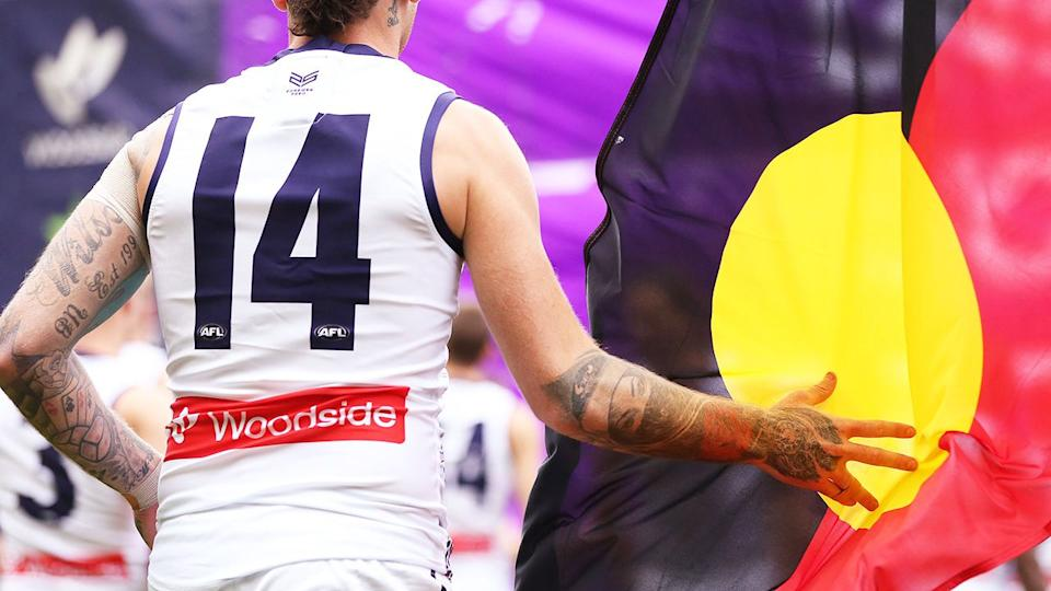 The Aboriginal flag, pictured here at an AFL game in 2019.