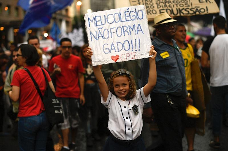 A girl demonstrates in Rio de Janeiro, on May 15, 2019 (AFP Photo/MAURO PIMENTEL)