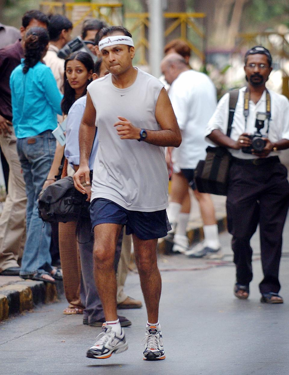 Anil Ambani, head of India's largest private sector company Reliance Industries, runs from his home to a polling stating to be one of the first to cast his vote when polling stations opened at 7:00 am (0130 GMT) in Bombay, 26 April 2004. Ambani, a marathon runner, jogged to and from the polling station in southern Bombay as the third phase of India's general elections, the world's largest democratic exercise, got under way with more than 172 million people eligible to vote for 1,278 candidates in 137 constituencies. AFP PHOTO/Rob ELLIOTT