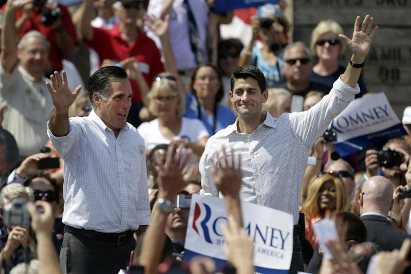 Republican presidential candidate, former Massachusetts Gov. Mitt Romney, left, and his vice presidential running mate, Rep. Paul Ryan, R-Wis., greet supporters during a campaign event at the Long Family Orchard Farm and Cider Mill in in Commerce Township, Mich., Friday, Aug. 24, 2012, (AP Photo/Paul Sancya)