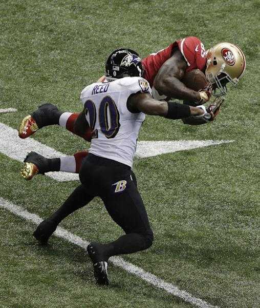 765265f4c San Francisco 49ers tight end Vernon Davis (85) is tackled by Baltimore  Ravens safety