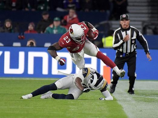 Oct 22, 2017; London, United Kingdom; Arizona Cardinals running back Adrian Peterson (23) is tackled by Los Angeles Rams cornerback Kayvon Webster (21) during an NFL International Series game at Twickenham Stadium. Mandatory Credit: Kirby Lee-USA TODAY Sports