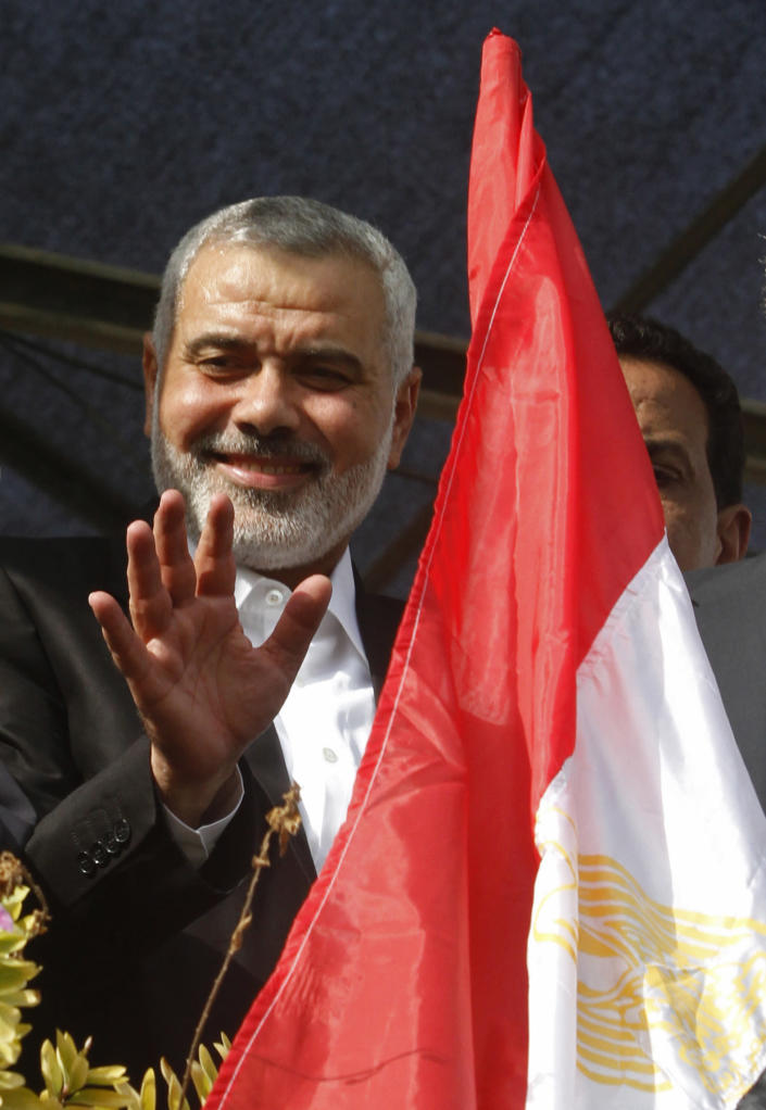 Gaza's Hamas Prime Minister Ismail Haniyeh waves at the crowd during a rally celebrating the Israel-Hamas cease-fire in Gaza City, Thursday, Nov. 22, 2012. Gaza residents cleared rubble and claimed victory on Thursday, just hours after an Egyptian-brokered truce between Israel and Gaza's Hamas rulers ended the worst cross-border fighting in four years. (AP Photo/Hatem Moussa)