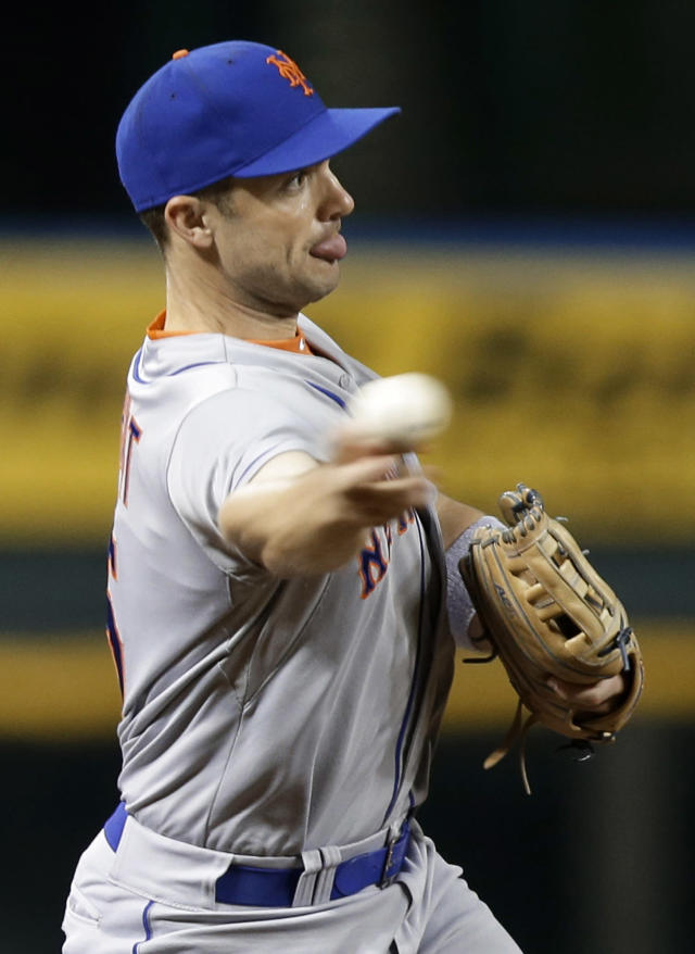 New York Mets third baseman David Wright throws to first for the out after fielding a ground ball hit by Cincinnati Reds' Devin Mesoraco in the fourth inning of a baseball game, Tuesday, Sept. 24, 2013, in Cincinnati. (AP Photo/Al Behrman)