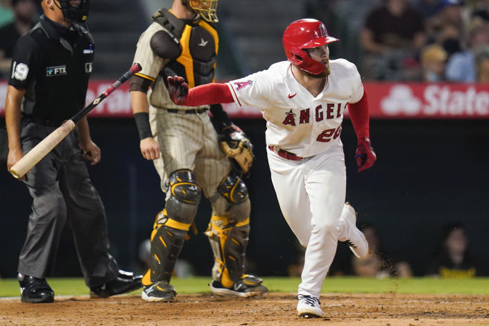 Los Angeles Angels' Jared Walsh, right, watches his RBI-double during the fourth inning of a baseball game against the San Diego Padres in Anaheim, Calif., Saturday, Aug. 28, 2021. (AP Photo/Jae C. Hong)