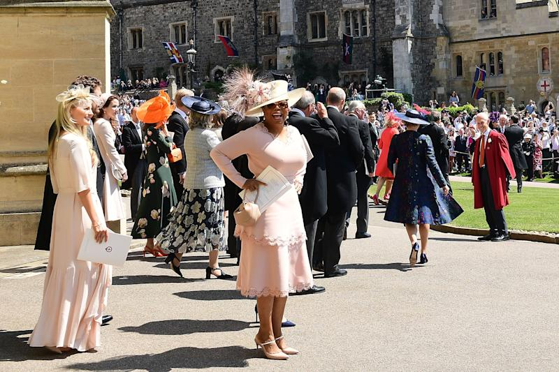 Oprah Winfrey leaves after attending the wedding ceremony of Prince Harry and Meghan Markle at St George's Chapel, at Windsor Castle on May 19, 2018.  (Photo: IAN WEST via Getty Images)