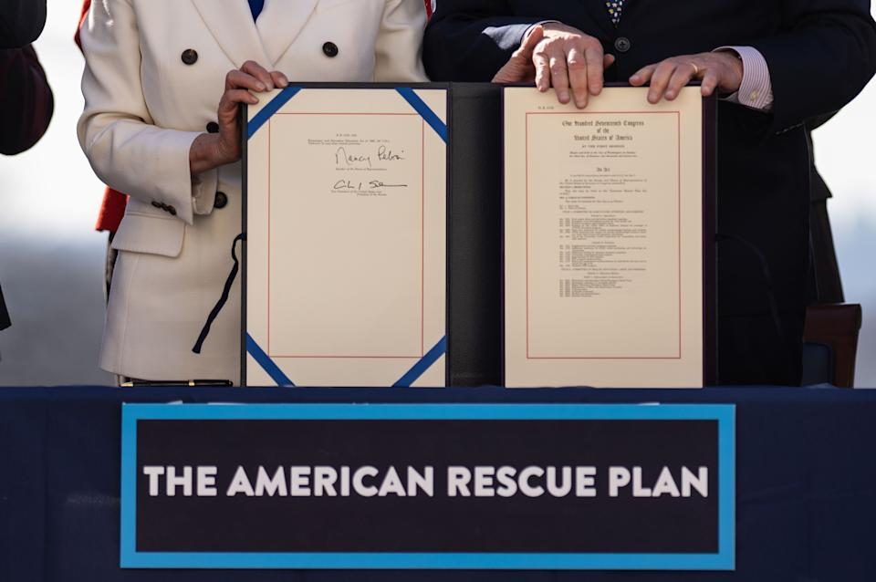 Speaker of the House Nancy Pelosi (D-CA) and Senate Majority Leader Chuck Schumer (D-NY) sign H.R. 1319 American Rescue Plan Act of 2021during a bill enrollment ceremony on Capitol Hill on Wednesday, March 10, 2021 in Washington, DC.  (Kent Nishimura/Los Angeles Times via Getty Images)