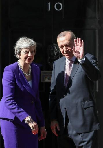 Britain's Prime Minister Theresa May greets Turkey's President Recep Tayyip Erdogan outside 10 Downing Street on May 15, 2018