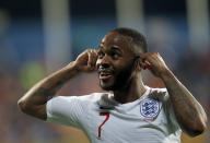 FILE - In this Monday, March 25, 2019 file photo, England's Raheem Sterling celebrates scoring his side's fifth goal after hearing racist chants, during their Euro 2020 group A qualifying soccer match against Montenegro at the City Stadium in Podgorica, Montenegro. FIFA is doubling its minimum ban for racist incidents to 10 games, and will start inviting players to make victim statements at disciplinary hearings. Stricter handling of racism and discrimination allegations is a key theme of the redrafted FIFA Disciplinary Code which takes effect next week. (AP Photo/Darko Vojinovic, file)