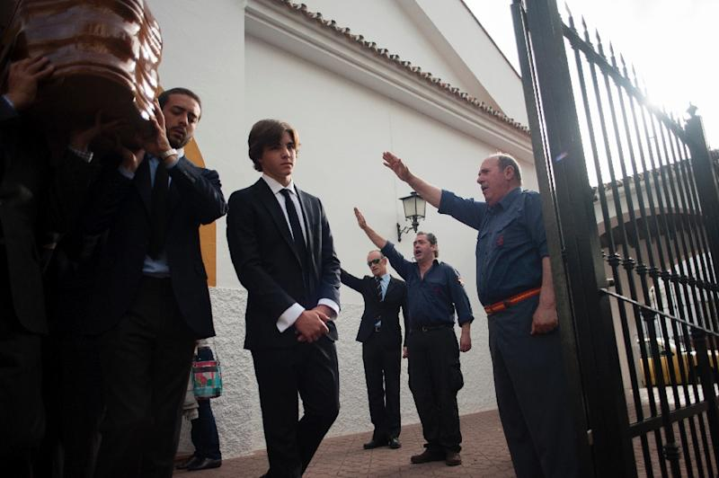 In April 2017 mourners made a fascist salute as one of the last ministers to serve under Franco, Jose Utrera Molina, was buried in Nerja in southern Spain (AFP Photo/JORGE GUERRERO)