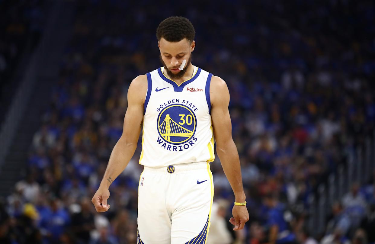 Stephen Curry suffered a broken left hand against the Suns. (Ezra Shaw/Getty Images)